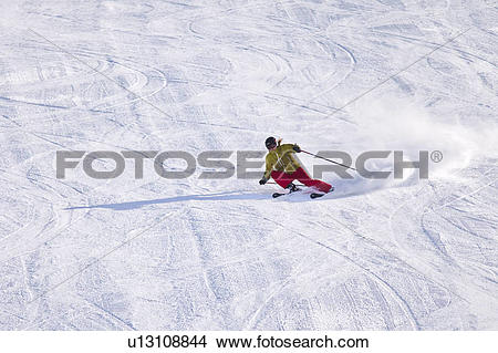 Stock Photo of Young female skier carving turns at Sunshine.
