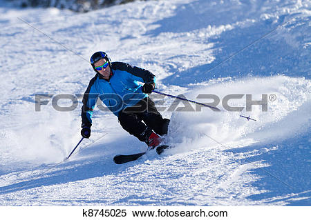 Stock Image of skier is carving down the hill k8745025.