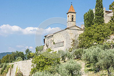 Church And Small Village In Tuscany Stock Photo.