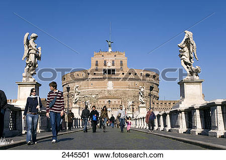 Stock Photography of Tourists walking on bridge in front of.