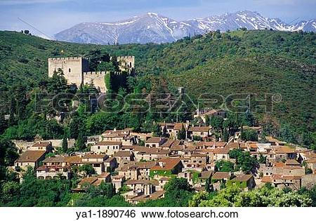 Stock Images of Village of Castelnou and back Canigou peak.