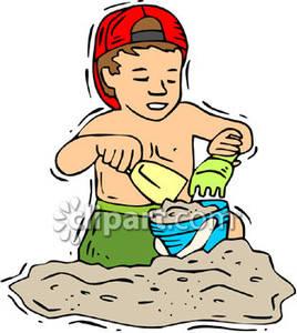 Boy Building A Sand Castle.