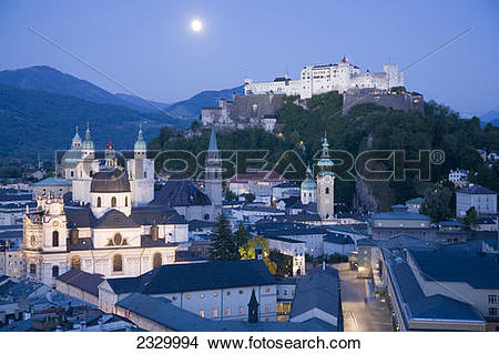 Stock Photo of Church in town with castle on hill in background.