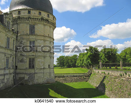 Stock Photography of A castle tower with the pit and the garden.
