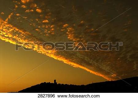 Stock Images of Silhouette of castle on hill at sunset, Marburg.