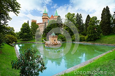 Castle Towers By The Pond Stock Vector.