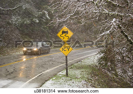 Stock Photo of Icy sign off highway 37 in snow, Castle Rock State.