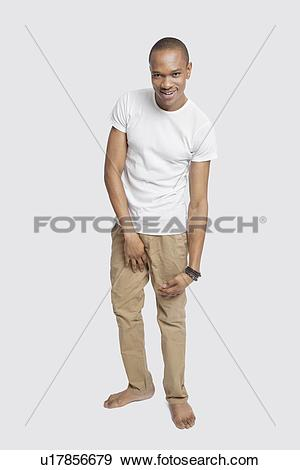 Stock Photograph of Portrait of young man in casuals smiling.