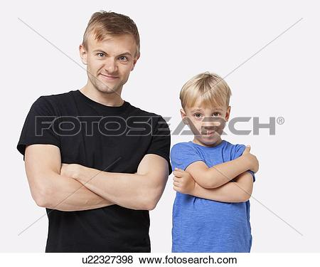 Pictures of Portrait of happy father and son in casuals with arms.
