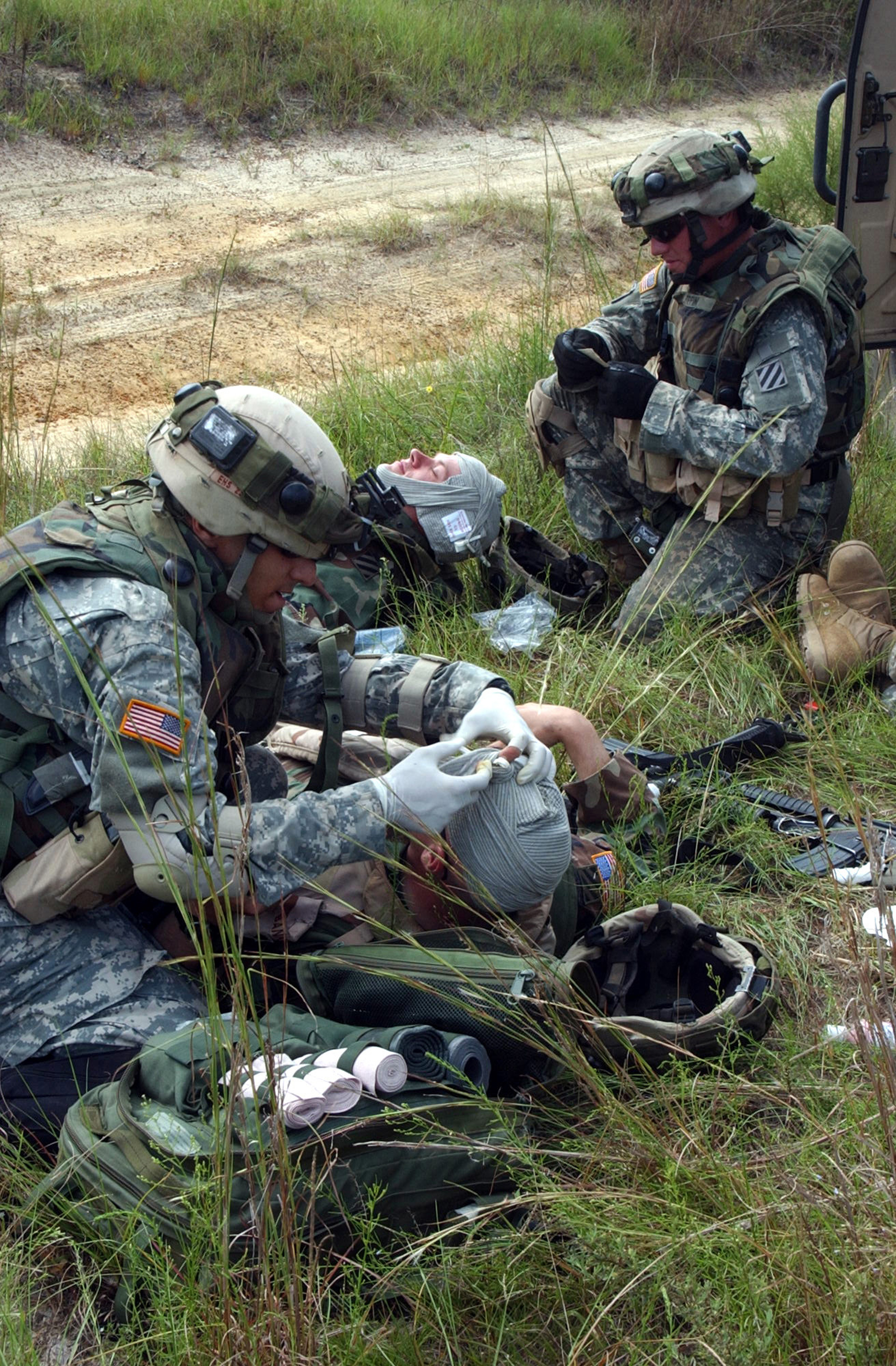 Stock Photo: U.S. Army Soldiers Care for Simulated Casualties.