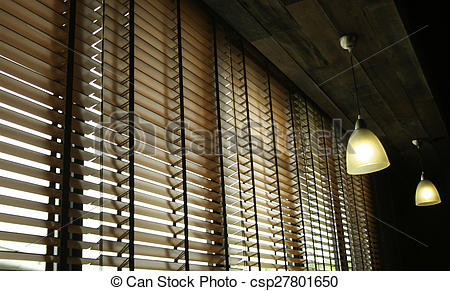 Stock Images of Blinds in a home catching the sunlight csp27801650.