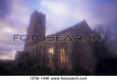 Pictures of Atmospheric English Decorated Gothic flint church with.