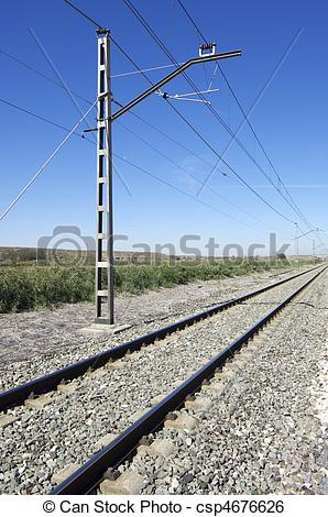 Stock Image of catenary of a railway track on a clear day.