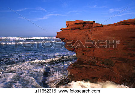 Stock Image of Surf and sandstone cliffs, Cavendish Beach, PEI.