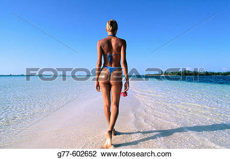 Stock Photo of Caribbean. Woman on tropical beach. Cuba, Cayo.