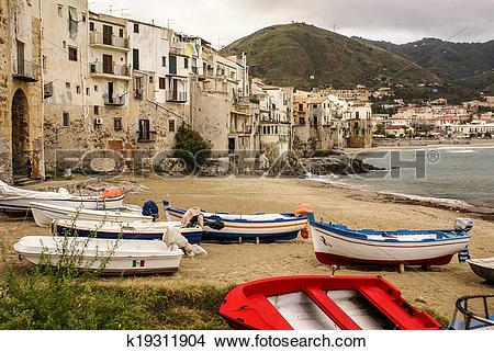 Stock Photo of Sicilian fishing boat on the beach in Cefalu.