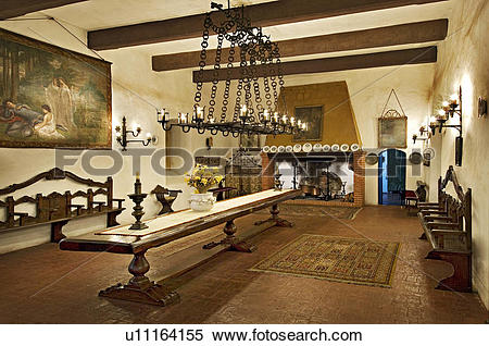 Stock Image of Italian dining room with long narrow table and.