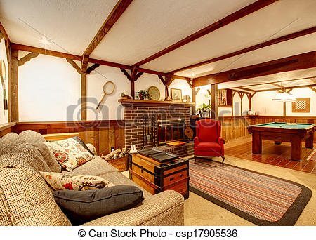 Stock Photos of Cozy living room with ceiling beams, rustic couch.