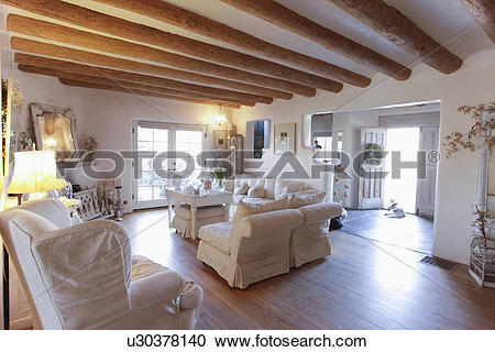 Stock Photography of Seating furniture with exposed ceiling beams.
