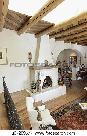 Picture of Spacious living room with exposed ceiling beams and.