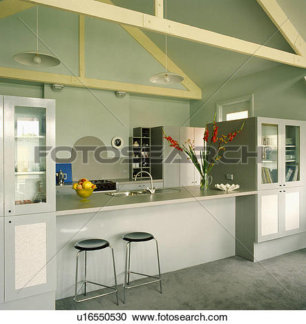 Stock Photography of Stools at breakfast bar in modern grey.