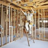 Pictures of Hispanic construction worker measuring ceiling in.
