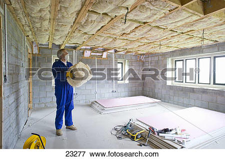 Picture of Man holding ceiling insulation in house under.