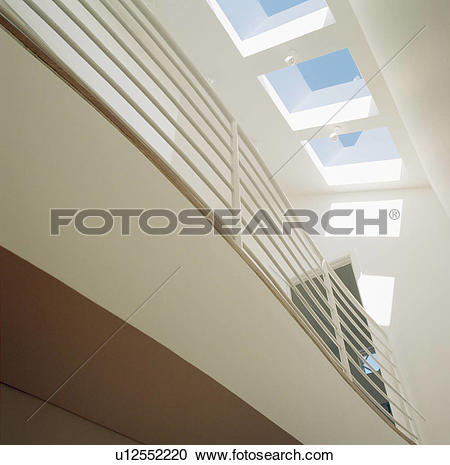 Stock Photography of Looking up at metal walkway and glass ceiling.