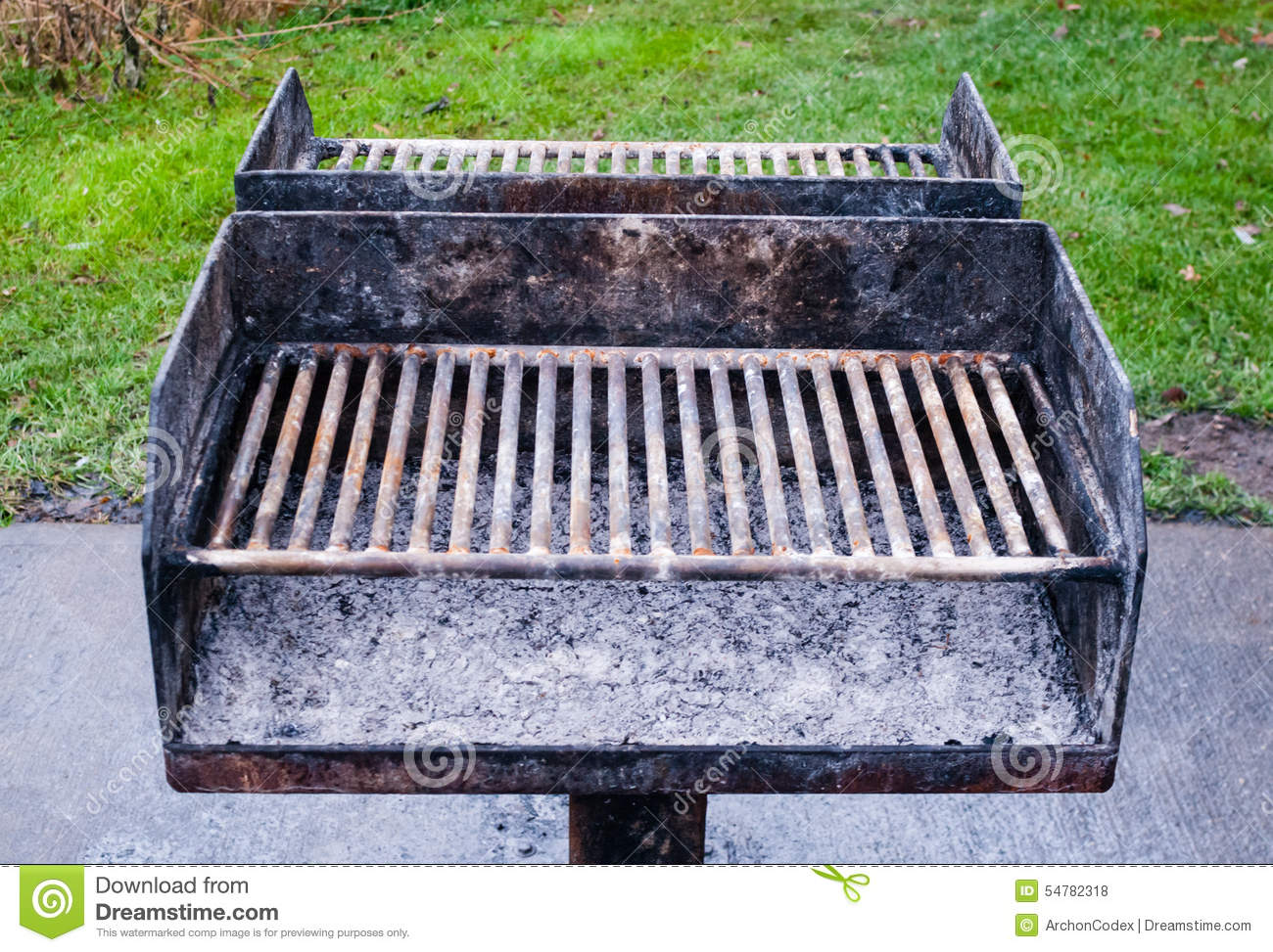 Dirty Metal Barbecue Grill With Ashes. Stock Photo.