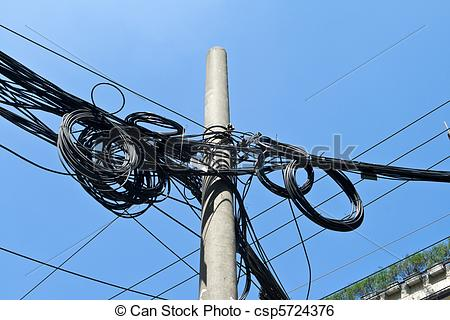 Stock Image of Mass of Telephone Electrical Wires On Cement Pole.