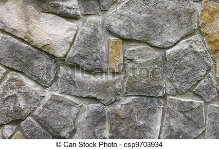 Stock Photo of Texture of a modern day rock wall cemented together.