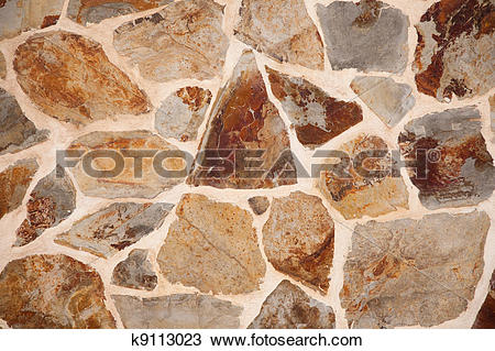 Stock Photo of Close up of stone wall with brown and grey.