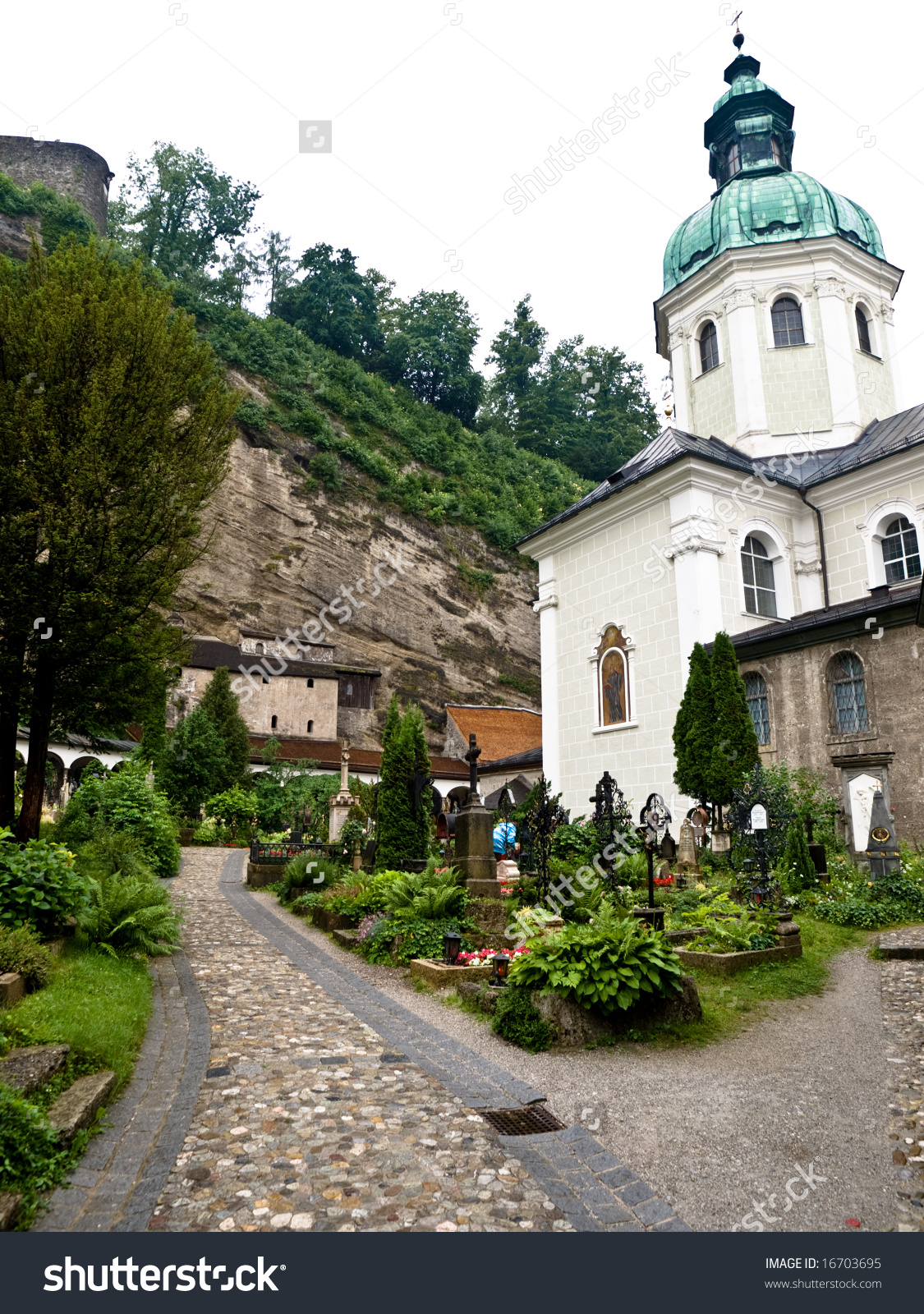 Tourist Attractions On The Old Salzburg Cemetery, Austria Stock.