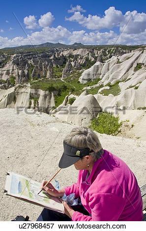 Picture of Woman paints landforms near Goreme, Cappadocia, also.