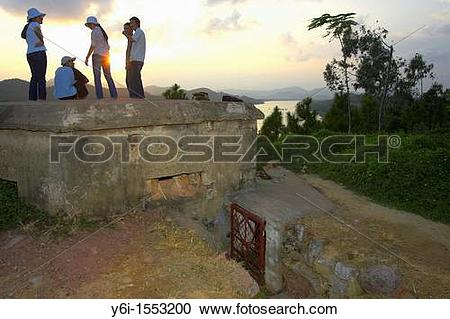 Stock Photography of Young visitors view Perfume River sunset on.