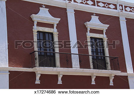 Stock Images of Windows on dark red building with white trim, 16th.