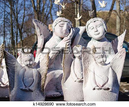 Stock Photography of cute clay ceramic angel figures fair market.