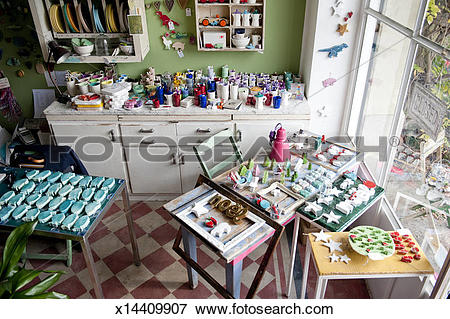 Picture of A colorful display of ceramic goods in a shop x14409907.