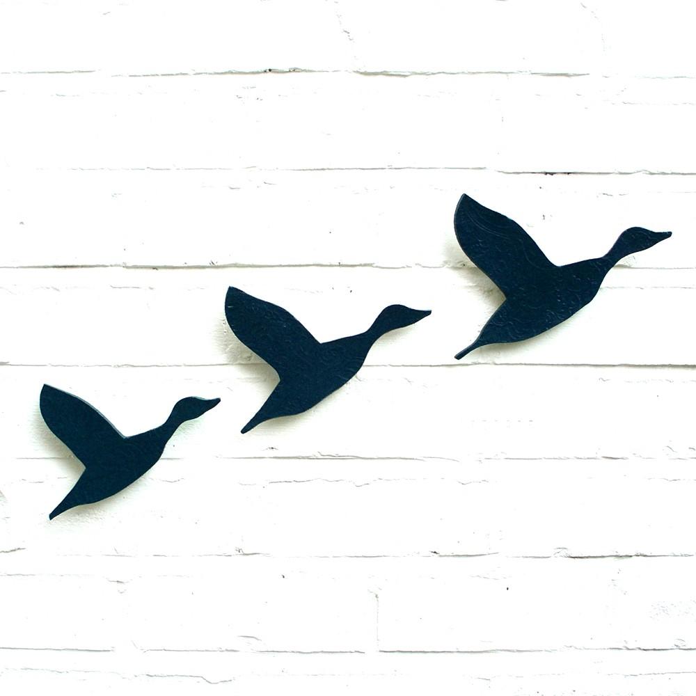 Ceramic wall art Flying ducks.