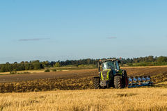 Agriculture Plowing Tractor On Wheat Cereal Fields Royalty Free.