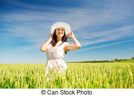 Stock Photographs of smiling young woman in straw hat on cereal.