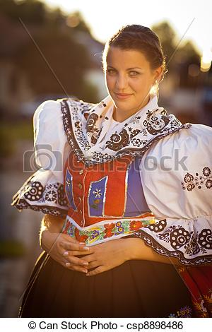Stock Image of Young woman in a ceremonial dress.