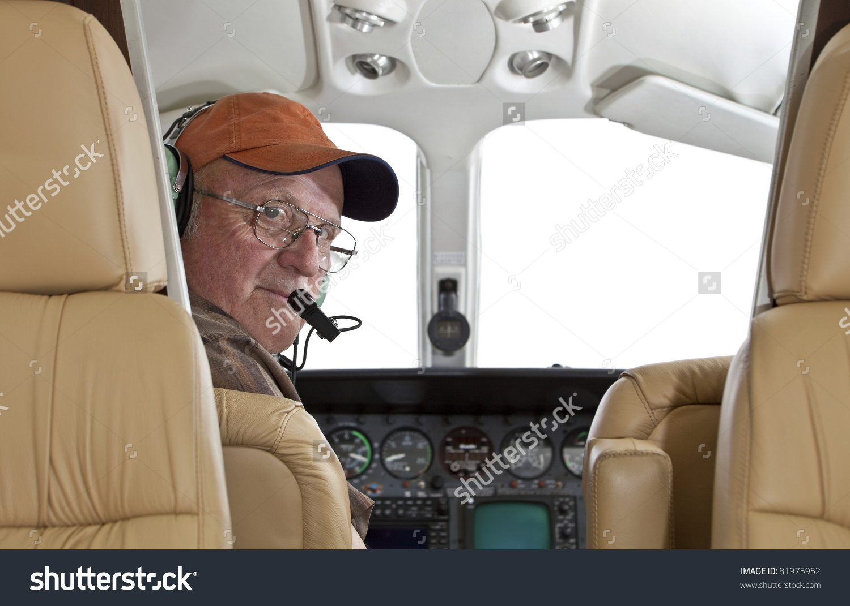 Pilot Looking Back Passenger Compartment Cessna Stock Photo.
