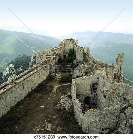 Stock Photograph of Castle of Peyrepertuse ruins on mountaintop.