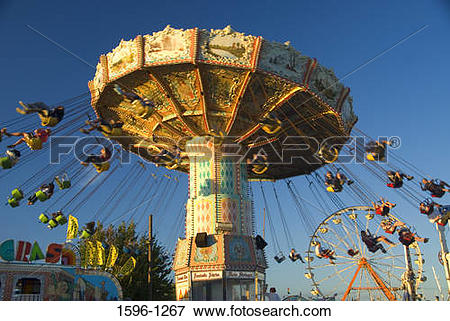 Picture of Group of people swinging on a chain swing ride in an.