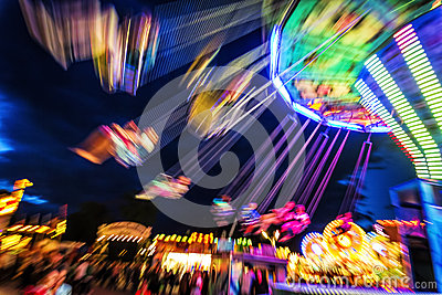 Traditional Chain Carousel At Night Stock Photo.