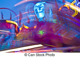 Stock Photo of Traditional chain carousel at night csp24808822.