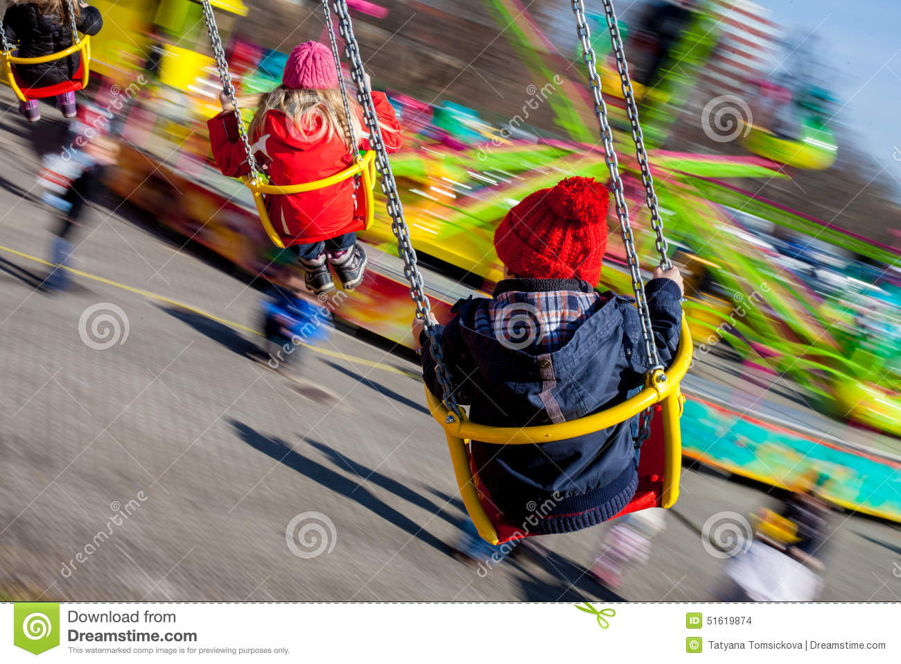Kids, Having Fun On A Swing Chain Carousel Ride Stock Photo.