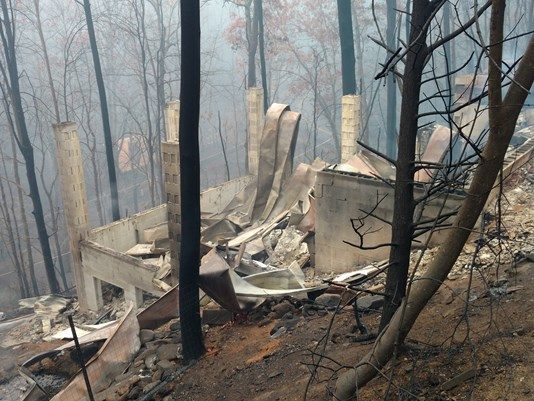 Gatlinburg couple loses home, but vows to rebuild.