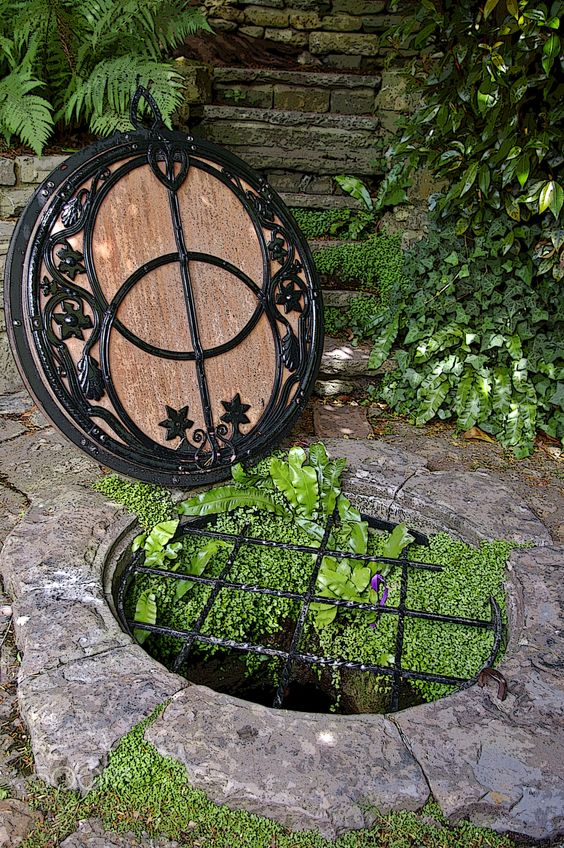 The wellhead under the Vesica Piscis symbol at the Chalice Well in.